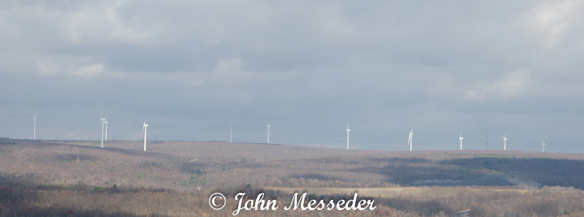 Wind turbines line a ridge overlooking Mahanoy City, Pa.