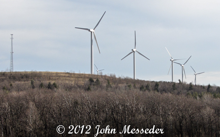 A row of 300-foot tall wind turbines visible from the Pennsylvania turnpike