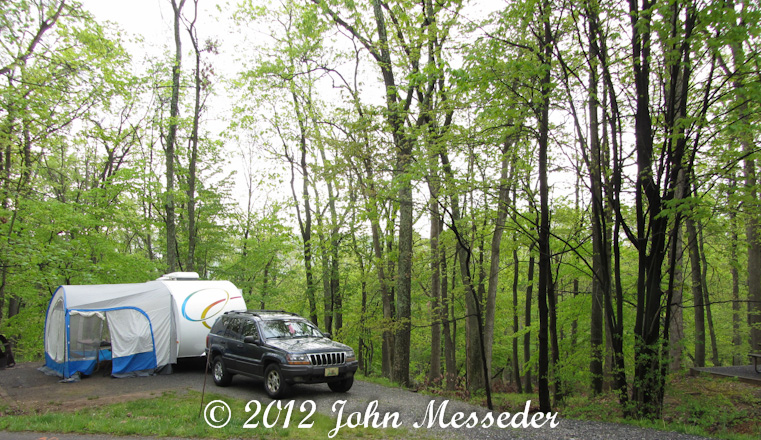 r-pod camper and Jeep Grand Cherokee tow vehicle in campground