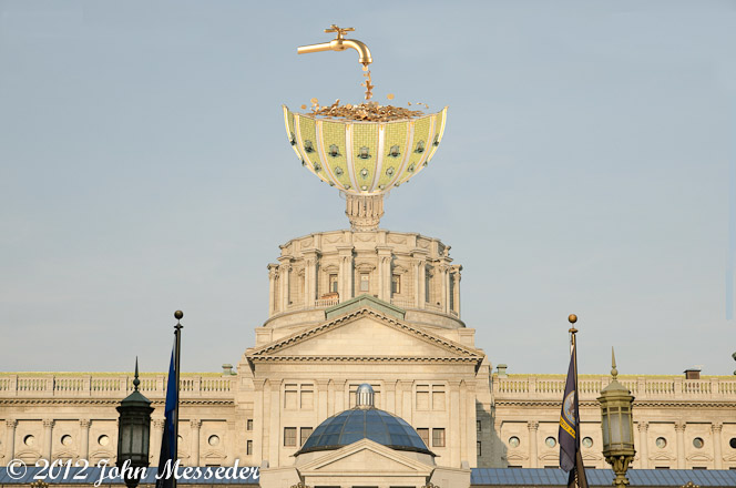 Fracking money pours from a golden faucet into capitol dome inverted to be a funnel