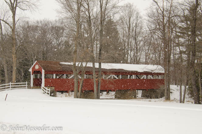 covered bridge in snowy woods
