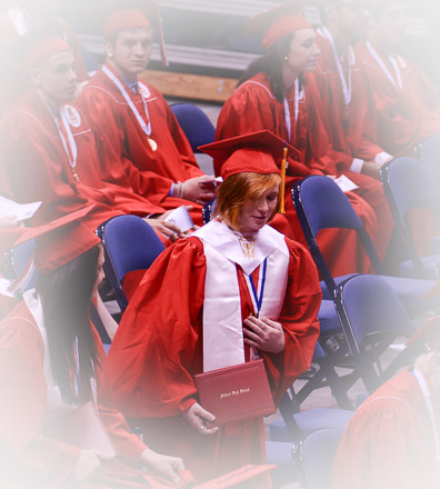 My first grandchild takes seat after receiving H.S. diploma