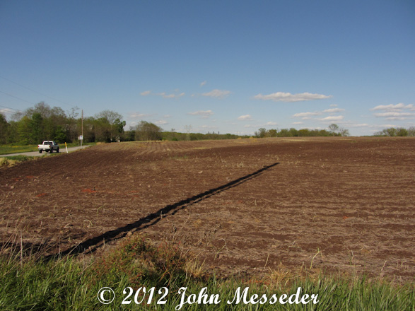 A field of plowed furrows awaits planting the new year's crop