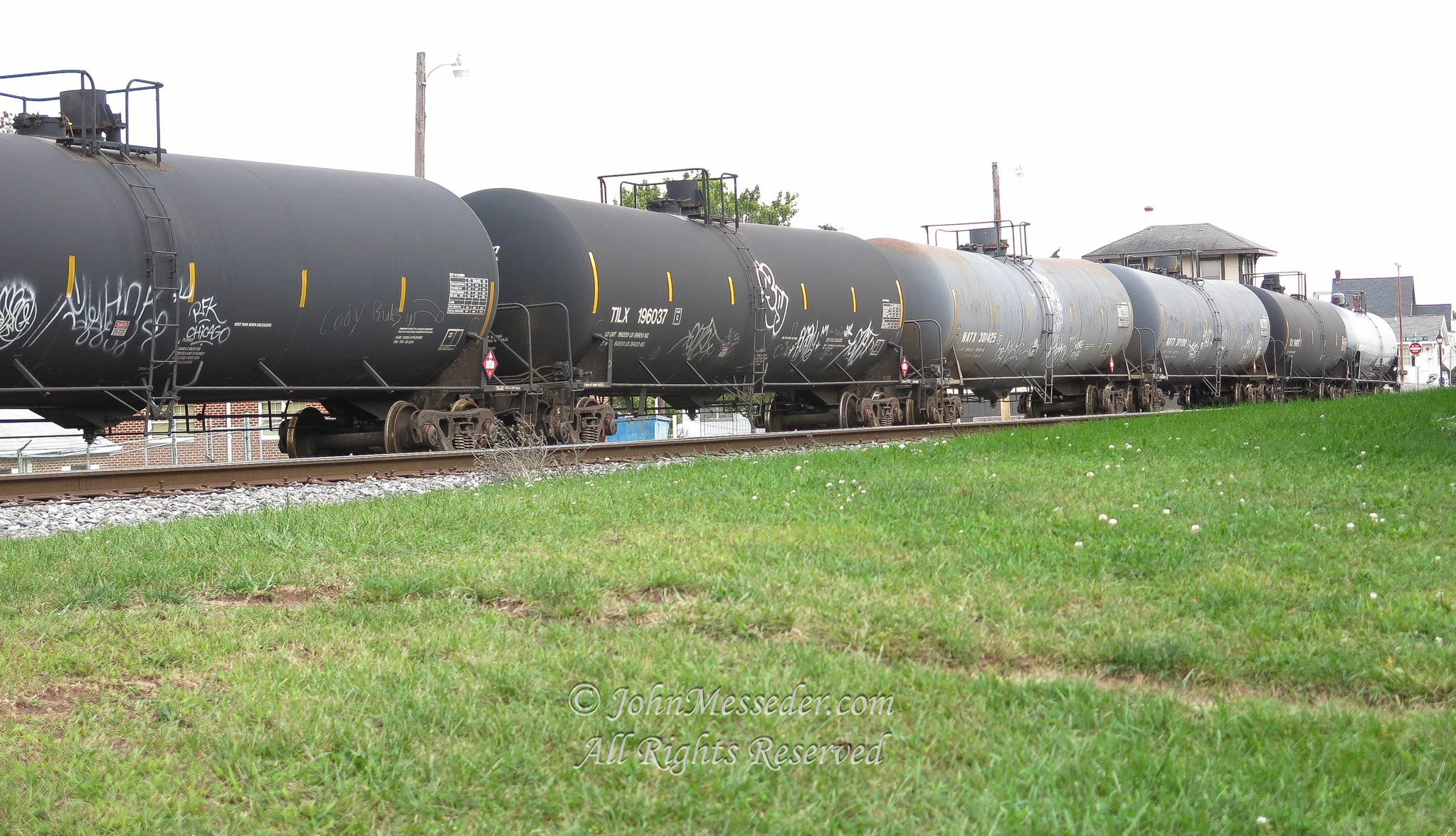 A line of 30,000 gallon railway tankers