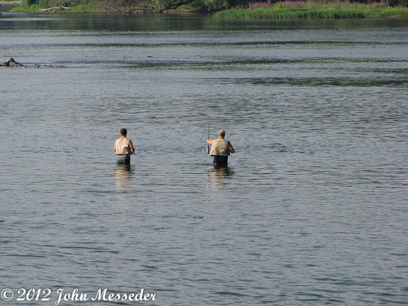 Two men fishing below the Harrisburg bridges.