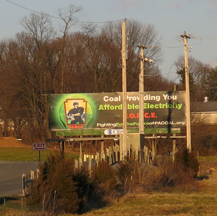 Fighting for the future of PA Coal dot org, billboard adjacent to a solar-powered meat packer.