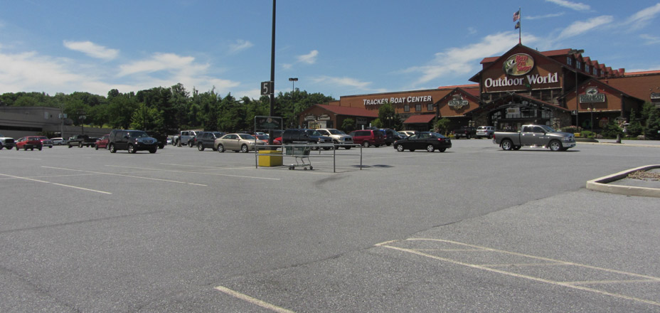 Bass Pro Outdoor World opens onto a blacktop desert,trees and grass replaced by pavement.