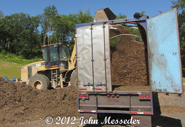 Loading mulch into a semi-trailer with a front loader requires hand-eye coordination and attention, not college
