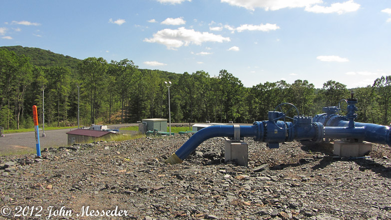Several pipelines arrive at a compressor collector before gas is sent over a mountain in Loyalsock State Forest