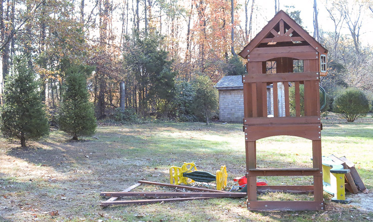 Partially disassembled play set awaits space on moving van