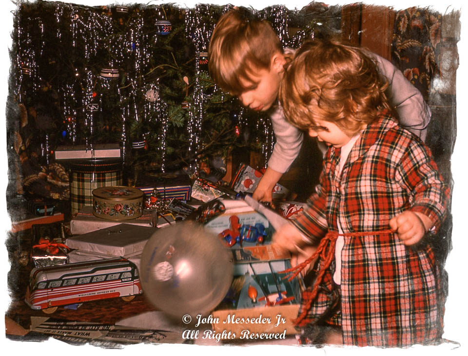 Brother and sister check out proof of Santa.