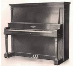 A black upright piano sat in the corner of the classroom at Roosevelt Grammer School.